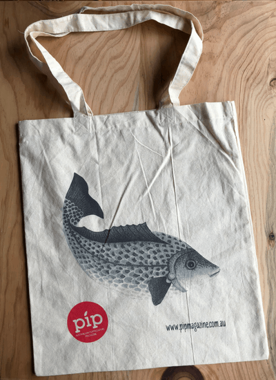 image of organic tote bag printed with drawing of fish from Issue 9 Pip Magazien
