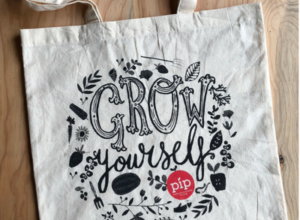 image of organic tote bag printed with Grow Yourself artwork